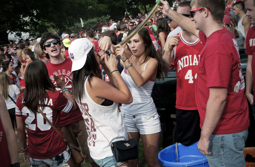 16 Sep 2012, Bloomington, Indiana, USA --- Students tailgating before a football game at Indiana University. --- Image by © Adam Reynolds/Corbis ref:http://www.vocativ.com/culture/society/college-jello-shots/